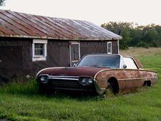 Old house and abandoned Thunderbird