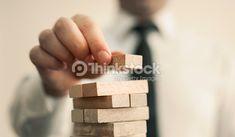 Foto de stock : businessman builds a tower