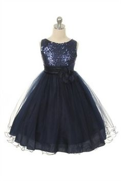 Girl's Navy Blue Sequined Bodice with Layered Mesh Skirt  This stunning gown has a sparkly sequin bodice that will make her shine. Sewn with an elegant tea-length glitter mesh skirt that gives this dress a light and comfortable feel for your girl. A beautifully crafted floral accent is pinned on the satin waistline.