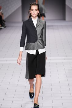 Viktor and Rolf - love the two tone blazer and the white peeking out.