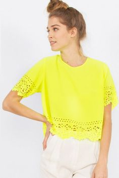Brighten up your Style and let the sun shine with this Adorable neon yellow chiffon top with laser cut details around the sleeves and hem.