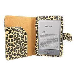 """Leather Folio Case for Amazon Latest Generation 2011 Kindle 4 (Non Touch) 6"""" - Leopard DESIGN + Screen Protector by KIQ. $9.95. Specifically designed for Amazon Kindle 4th Generation ·  Holds the device securely in place, while providing maximum protection and still allowing the user to access all the buttons, ports, and screen ·  Case is closed with a magnetic button ·  Left hand side has a flap to hold papers ·  Front cover can flip to the back and be hold by o..."""