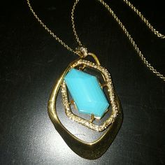 Turquoise Stone Pendant Gold necklace Super chic, Turquoise colored stone pendant surrounded by crystals. Long chain necklace in gold. Jewelry Necklaces