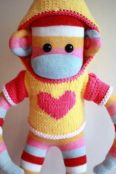 sock monkey wearing a hoodie. Oh so cute!