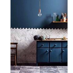 This caught my eye. There is something to be said for those dark walls, cabinets…