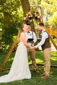 This laidback couple had a colorful, outdoor Colorado wedding at Lyon's Farmette. They built this triangle wooden ceremony arch for their backdrop topped with colorful wedding flowers. To see more from this wedding day check out the rest of the blog! Ceremony Arch, Wedding Ceremony, Wedding Venues, Wedding Day, Rain Photography, Relaxed Wedding, Geometric Wedding, Wedding Colors, Wedding Flowers