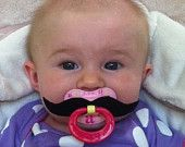 Right up there with the beard hat.    Mustache Pacifier. $9.00, via Etsy.