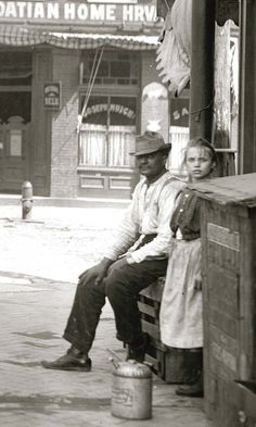 A Croatian immigrant and his daughter sitting outside a business on the near south side of St. Description from stl250.org. I searched for this on bing.com/images