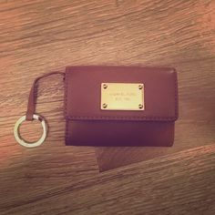 MICHAEL KORS wallet Great condition, tan color. Has many slots on the inside and outside. Attached key ring. MICHAEL Michael Kors Bags Wallets