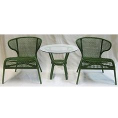 """Wicker Table & 2 Chairs Green Set Of 3 by FantasticDecor. $529.99. Buy multiple items, save on shipping. Bring comfort and beauty to your patio or backyard living space. The set of three wicker table and chairs combines style and class design, giving you a rich addition to any outdoor setting. Its durable frame will supply you with comfort and stability. Made of wicker. Measures table: D21.3""""x22.4"""", chair: 28""""x27.2""""x29.5"""" each."""