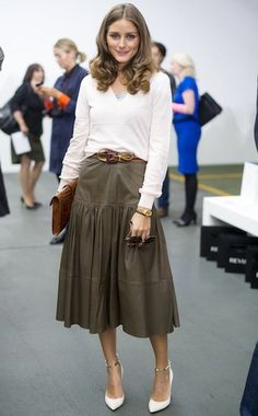 Olivia Palermo in a simple white sweater, olive midi skirt, and white ankle strap heels