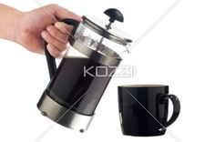 human hand serving coffee. - Cropped image of a human hand serving coffee in a black cup.