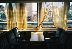 Romantic yellow drapes in train carriage.
