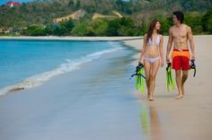 Photo about A young couple with snorkelling gear on a tropical beach. Image of honeymoon, beach, adults - 4987411 Honeymoon Destinations, Honeymoon Ideas, Couple Beach, Snorkelling, Young Couples, Maldives, Bikinis, Swimwear, Tropical
