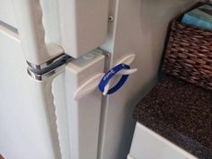 Kitchen Fun With My 3 Sons   Use two Command Hooks and a Rubber Bracelet for a child Safety lock on the refrigerator....what a great idea!