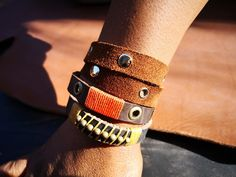 Leather bush armbands.  Shop online to design your own.  Visit www.alloutcreations.co.za