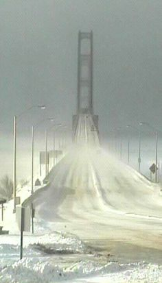 Mackinac Bridge in winter, State of Michigan, U.S - As beautiful as this bridge is in the summer - it scares me then - I would NEVER go near it looking like this!!