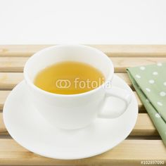 "Download the royalty-free photo ""The cup of Japanese green tea and green cotton fabric on wooden tray."" created by phasuthorn at the lowest price on Fotolia.com. Browse our cheap image bank online to find the perfect stock photo for your marketing projects!"