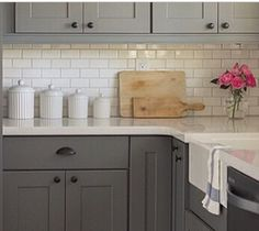 Grey cabinets, white subway tile.