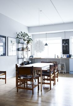 Modern and nordic dining room featuring a dining table by Hay surrounded by chairs from Boerge Mogensen.