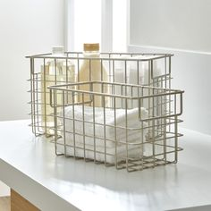 Modern, easy-access storage in open weave steel wire basket with a matte nickel finish. Wide handles for easy portability. These wire baskets provide storage for a wide variety of items and fit with any style. Use them with or without the basket liner for a custom look that's all your own.<br /><br /><NEWTAG/><ul><li>Steel</li><li>Matte nickel finish</li><li>Made in Taiwan</li></ul>