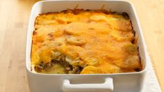 Potato and Ground Beef Gratin with Ground Beef, Salt, Pepper, Butter, Small Onion, Flour, Fresh Thyme Leaves, Milk, Shredded Mild Cheddar Cheese, Potatoes.