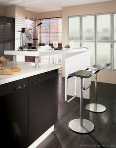 #Kitchen Idea of the Day: Modern Black Kitchen (By ALNO, AG) with an elevated island bar.