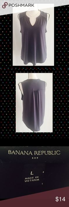 Sleeveless charcoal gray blouse  Lovely sleeveless gray blouse by Banana Republic.  Looks amazing with dark slacks and your hottest pair of pumps  95% Polyester 5% Spandex / Elastane.  GORGEOUS!!! Banana Republic Tops Blouses