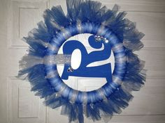 Tulle wreath I made for my mother-in-law! I painted a wood letter from Hobby Lobby and added a few sparkly gems to it, then tied that to the wreath. I'm happy with how it turned out and plan to make more!