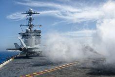 The steam clears after an aircraft launch aboard the USS John C. Stennis (CVN 74).