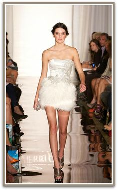 Kendall Jenner rocks the catwalk in this Ostrich Feather trimmed dress by designer Sherri Hill at the 2012 New York SS Fashion Week! The perfect look for an edgy bride who wants to stand out at her bridal shower or rehearsal dinner. Sexy & SUPER Sweet…!
