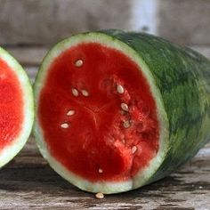 Strawberry watermelon is one of our favorites! Gorgeous strawberry pink flesh that ripens withing a half-inch of the rind with very few seeds. Super sweet! Oblong, striped fruits reach 15-25 pounds. M