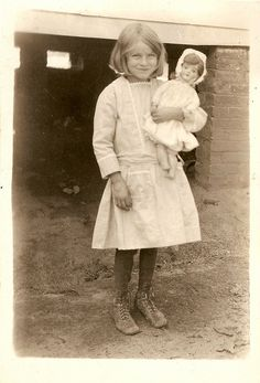 little girl and doll by the-feathered-nest.blogspot.com, via Flickr