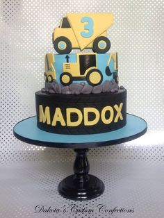 I made this cake for my nephew's birthday. He loves all kinds of construction vehicles so that was the theme. The dump truck was made of rice crispies and the tire texture was made using a chevron cutter and a straight edge to make an. Excavator Cake, Construction Birthday Parties, Construction Cakes, Fire Engine Cake, Dump Truck Cakes, Dinosaur Cake, Dinosaur Birthday, Cakes For Boys, Boy Cakes