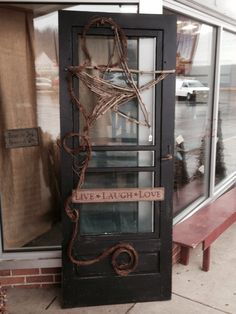 """""""Made""""-- had the old screen door.  The wife painted and distressed.  I made star from sycamore.  Can go outdoors with no problems.  (Selling for $89.99 at Country Collections in Lancaster, Ohio)."""