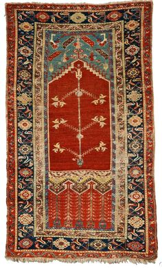 Ladik Prayer Rug, Central Anatolia, late 18th/early 19th century, (areas of wear mostly in oxidized brown areas, some selvage damage, slight end fraying), 5 ft. 10 in. x 3 ft. 6 in.