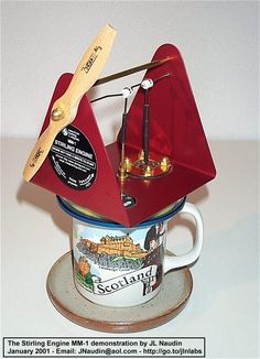 A Stirling engine which runs on a coffee cup by JL Naudin Diy Projects Engineering, Stirling Engine, Small Engine, Steam Engine, Mechanical Engineering, Science And Nature, Cool Gadgets, Coffee Cups, Diy And Crafts