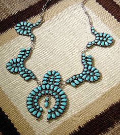 Zuni Cluster Necklace ca. 1950  Petit point Morenci turquoise in sterling silverwith hand forged silver chain and clasp.