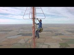 Changing A Light Bulb 1500 Feet Off The Ground! : Video Clips From The Coolest One and I have trouble climbing a 6' ladder lol