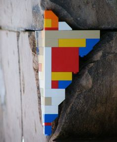 A missing brick here and chipped stone there show the normal marks of wear and tear on the structures and streets of a city, but filling them in with multi-colored LEGO bricks makes them stand out in sharp relief with their surroundings – especially in a place like Berlin