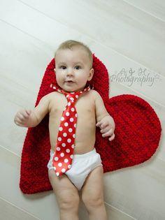 Valentine day. Boy. Photography. Hearts