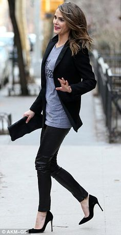 Simple style: The brunette beauty kept it simple with leather skinny trousers and a black ...