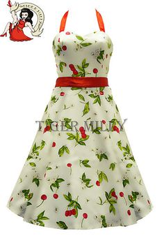 #Rockabilly dress I bought for Christmas day as it looks a bit like holly (they're cherries). No underskirt provided with this one but looks good with a petticoat, feels great and looks amazing with one of Banned's red cardigans.