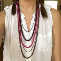 """Layered Necklace This long necklace is composed of a mixture of brass colored metal and magenta and purple beads. 16"""" top to bottom. A couple strands missing (as pictured) but not noticeable from front. Jewelry Necklaces"""