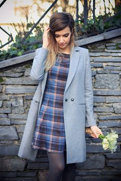 Plaid dress and cute coat. I also like the colored tights!