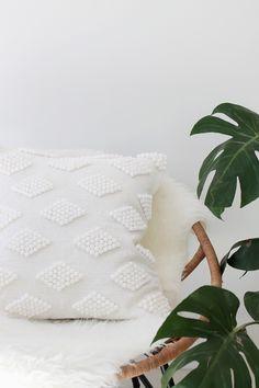 Glue pom poms onto a pillow case to make a boring cushion decorative.   55…