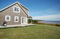 Looking for a Prince Edward Island vacation rental? Browse the best selection of PEI vacation cottages to rent. Book your vacation today! Gray Lady, Beach Houses For Rent, Waterfront Property, Prince Edward Island, Cottages, Outdoor Structures, Cabin, Vacation, House Styles