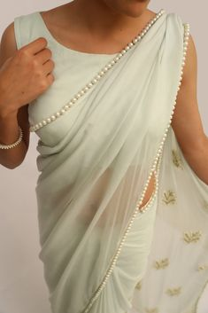Featuring an icy mint pure chiffon saree with pearl-lined border and exquisite tiny pearl bouquet embroidery on pallu, set in gold-embroidered branches. Please visit this link to purchase the saree. Please visit this link to purchase the saree. Plain Chiffon Saree, Plain Saree, Chiffon Blouses, Silk Chiffon, Indian Dresses, Indian Outfits, Saris Indios, Saree Trends, Outfits