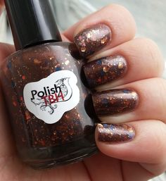 "Polish TBH's ""Chocolate Frogs"" two coats shown with two coats of KBShimmer's topcoat. Not too crazy about the slight curl in some of the gold glitters, but it's nothing a topcoat couldn't cure."