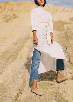 White tunic over pants